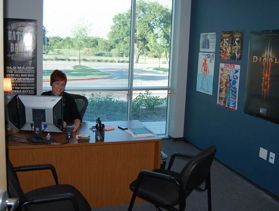 alum Anita Rice at her desk at Blizzard Entertainment